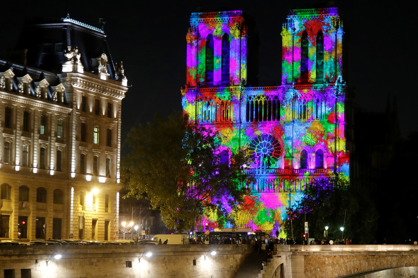 """A monument light and sound show, named """"Dame de Coeur,"""" by stage director Bruno Seillier, is projected on the facade of the Notre Dame Cathedral in October 2018."""