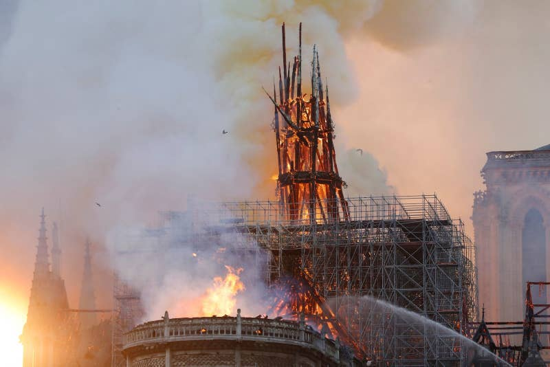 Smoke and flames rise during a fire at the landmark Notre-Dame Cathedral in central Paris on April 15, 2019.