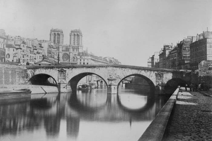 The Saint-Michel bridge, the Hôtel-Dieu, and Notre Dame Cathedral before 1857.