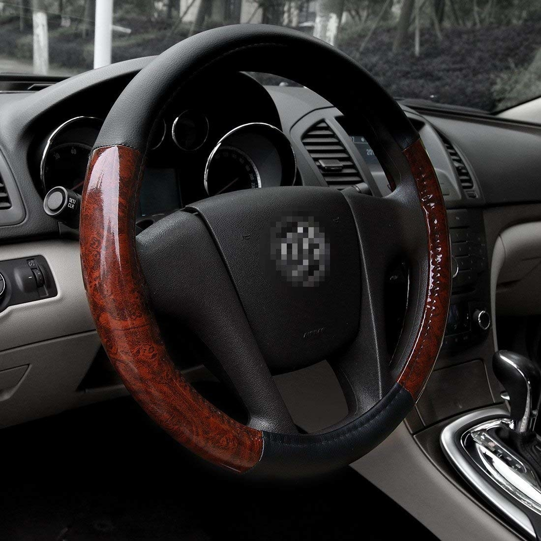A steering wheel with the wood grain cover
