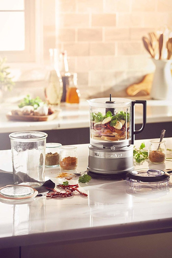"""Promising review: """"This is a very easy to use food processor that does an excellent job of chopping/pureeing food, and the whisk attachment is amazing! It's nice, and compact, and fits perfectly on the counter top with its cord neatly tucked in, and it's not bad to look at either. I now use this as my daily chopper."""" —cooking_mickeyPrice: $49.99 (available in two colors)"""
