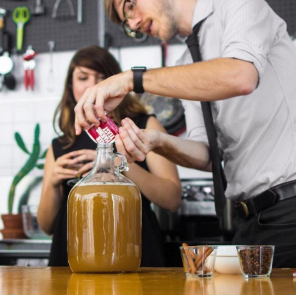 model pours powder into large jug