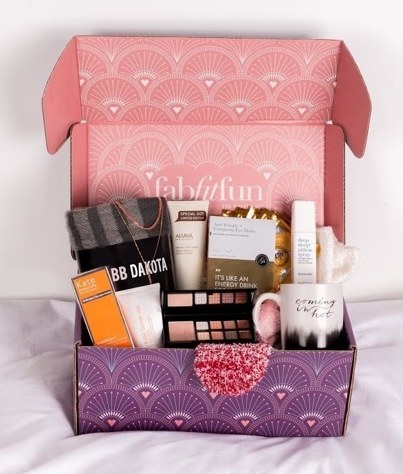 box open with all the goodies styled inside
