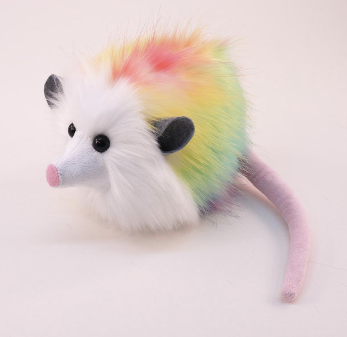 """This gorgeous creature has been sitting on my desk at BuzzFeed for several years now and she shall never leave her perch. You know how you're supposed to rest your eyes by looking away from your computer screen every so often? More often or not, my eye rest = staring into her deep ebony orbs. It's soothing."" —Mallory McInnisGet a rainbow possum of your very own (or another creature!) from Fuzziggles on Etsy for $35.95."