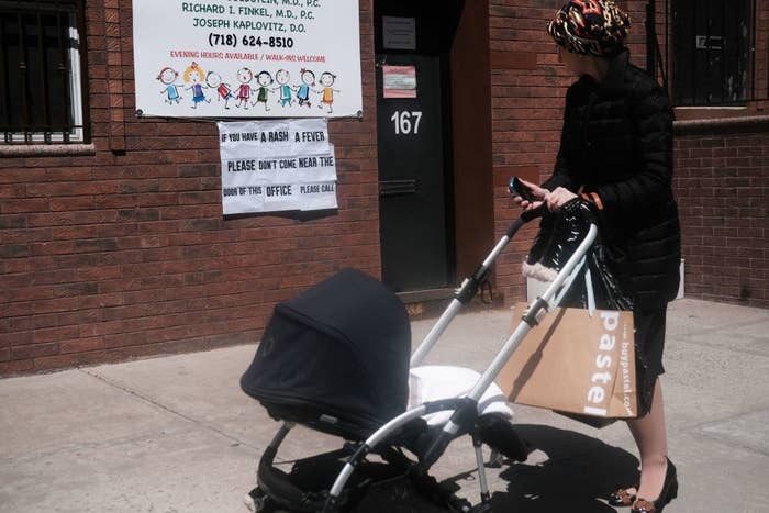 A sign warns people of measles in the ultra-Orthodox Jewish community in Williamsburg, Brooklyn.