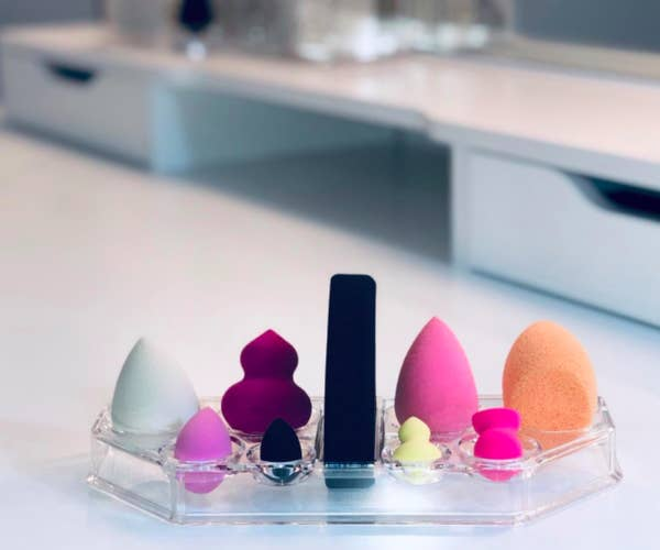 A customer review photo of the acrylic makeup sponge organizer.