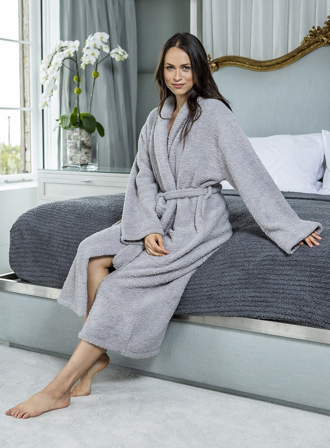 model wearing the mid-calf length fuzzy robe in light grey