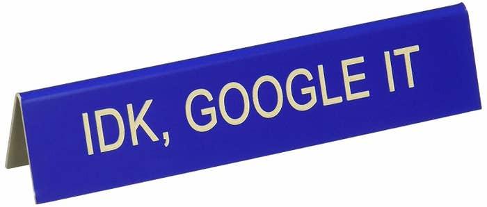 desk sign that says idk, google it