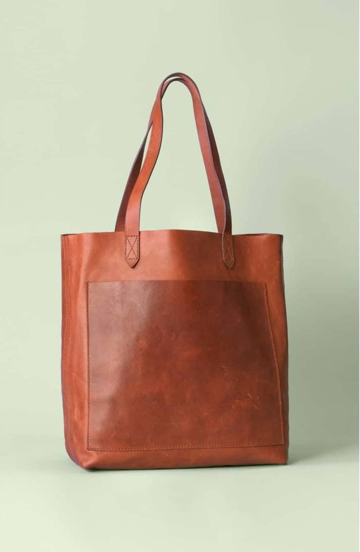 """Promising review: """"This is a great bag! I got the saddle color, and it looks fantastic. I love that I can see down to the bottom clearly in this bag. I like how it is gradually getting that aged look. It's a must-have bag! I'm so glad I bought this."""" —Norma44Price: $158 (available in brown, tan, and black)"""