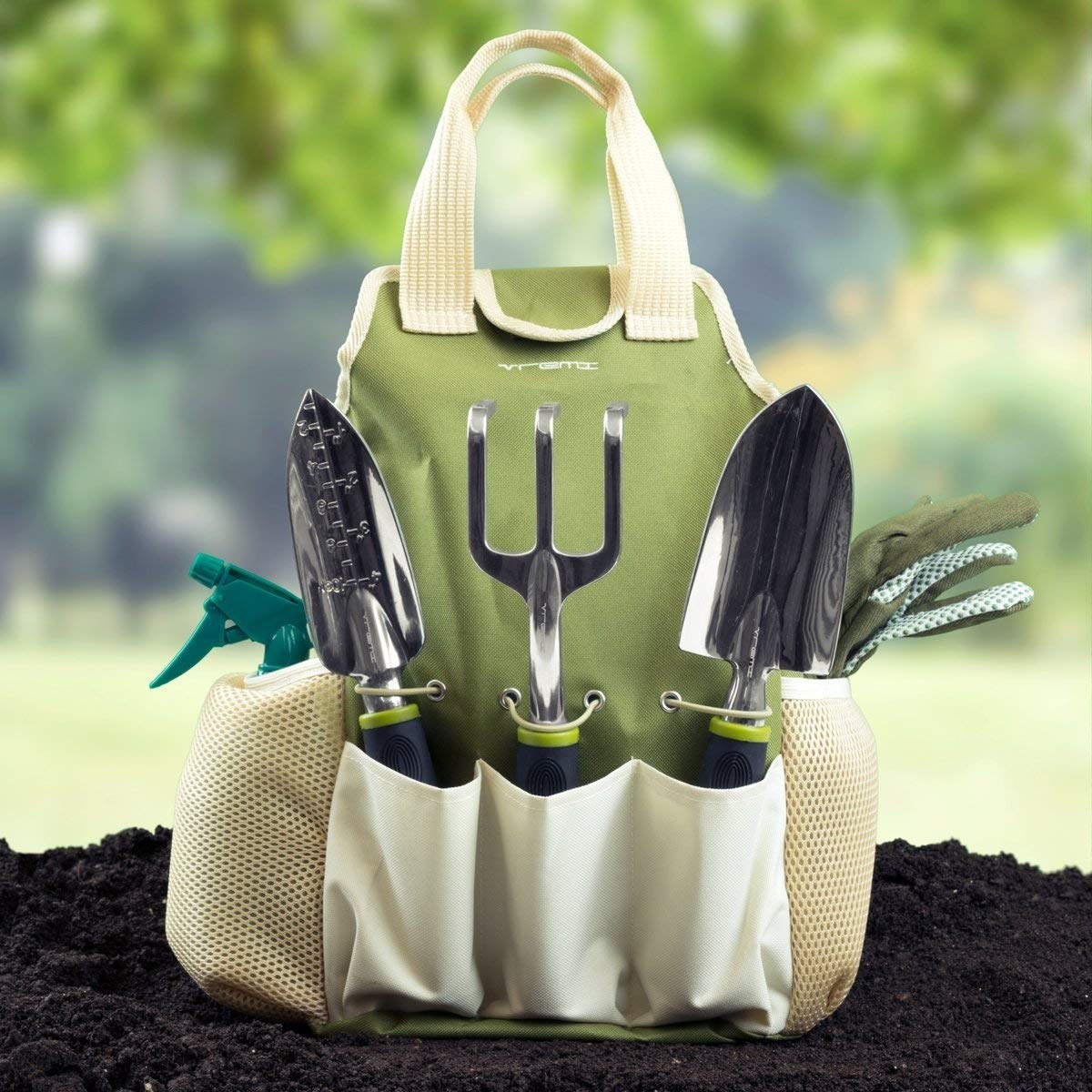 A carrying bag with tools like a spray bottle, tiny rake, a trowel, and gloves