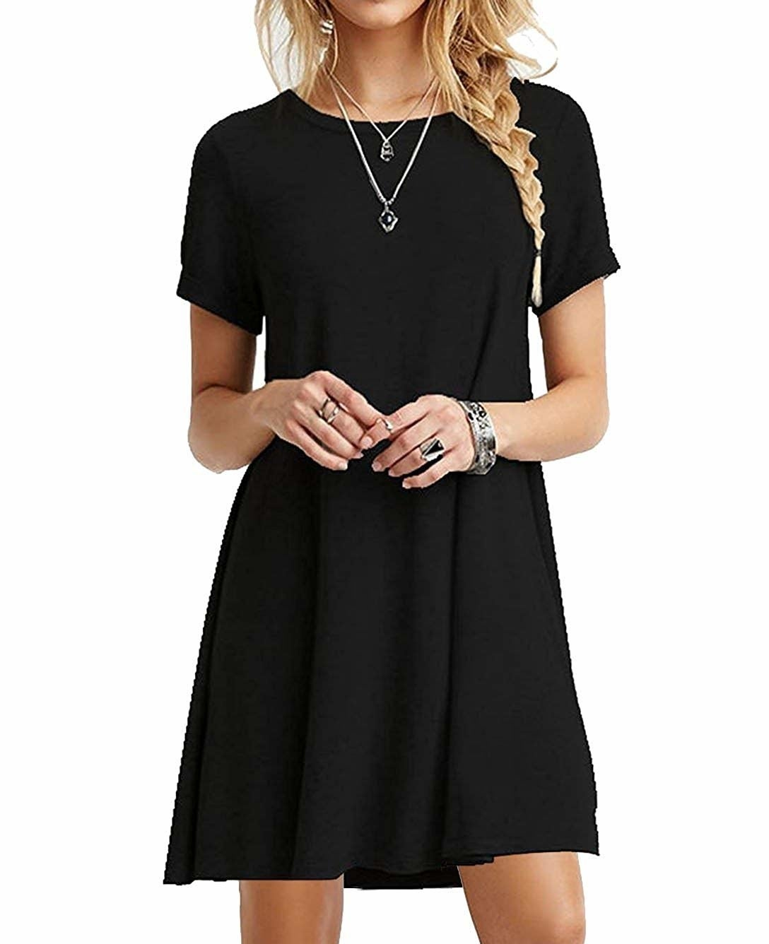 "Promising review: ""This simple T-shirt dress is a must have. The sizing is true, it drapes well, and it's comfortable. It needs to be washed in cold water and hung dry, and the fabric requires almost no ironing after hanging. It can be dressed up with jewelry and simple heels, or worn with flip-flops. I'll definitely be ordering a few more in different colors."" —MAPGet it from Amazon for $12.99+ (available in 20 styles, and sizes XS–XL)."