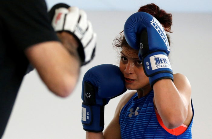 Iranian boxer Sadaf Khadem attends a training session in Royan, France, on April 11.