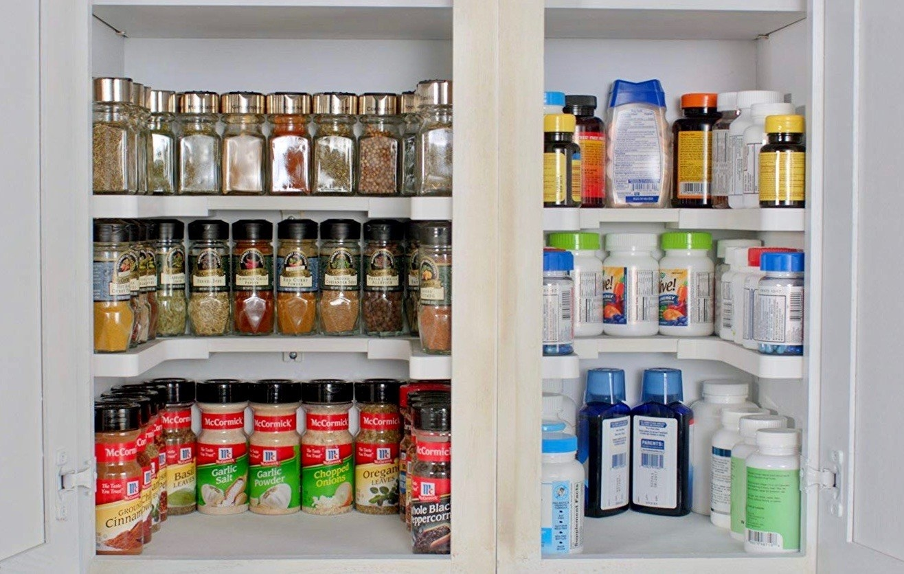 The shelving system used to organize a spice cabinet and a medicine cabinet