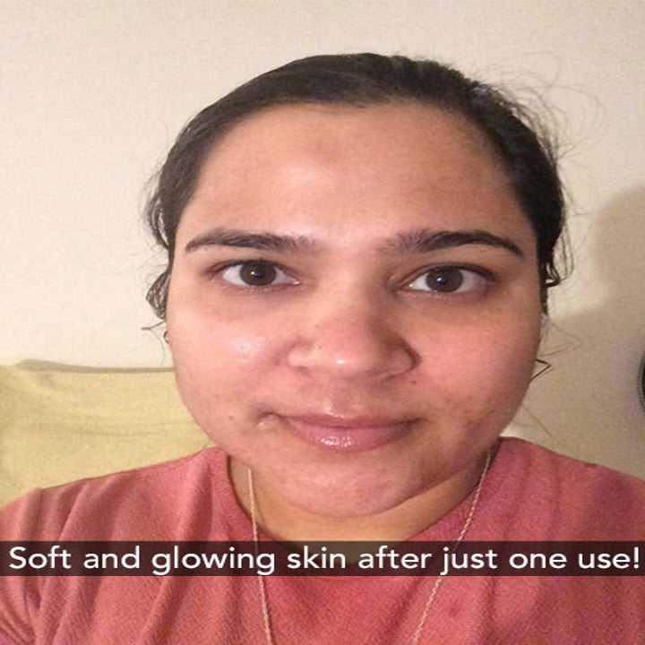 A reviewer with soft and glowing skin after just one use