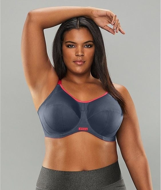 model wearing grey and pink sports bra