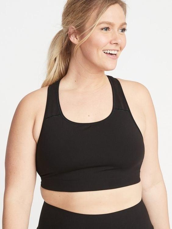 model wearing black sports bra