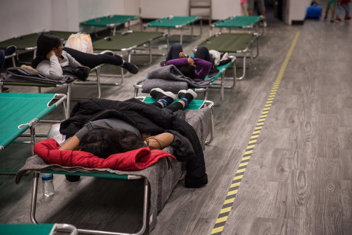 Immigrants sleep on cots in the Rapid Response Network shelter in San Diego. People generally only stay at the shelter for less than 72 hours, leaving local churches, such as Christ Ministry Center, to fill in the gaps.