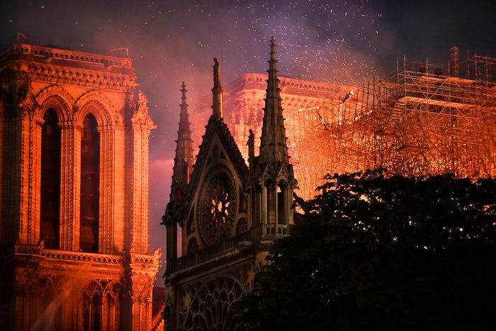 Flames burn through the roof of the Notre Dame Cathedral in Paris on April 15.