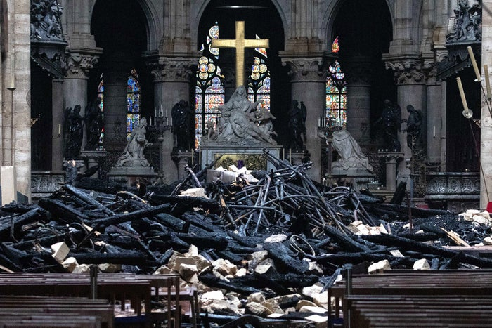 Fallen debris from the burnt-out roof near the high altar inside Notre Dame Cathedral on April 16.