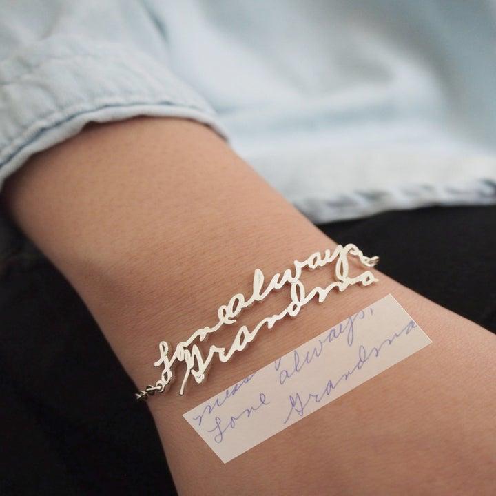 model wearing bracelet next to handwriting