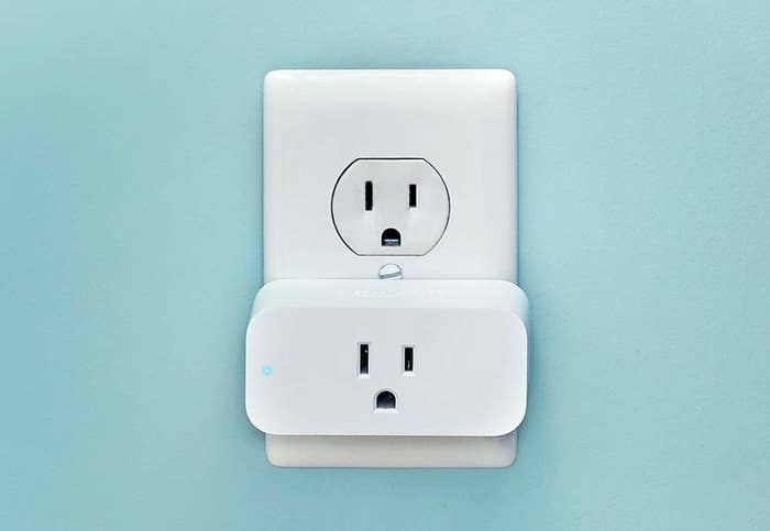 A white rectangle plug in a wall outlet