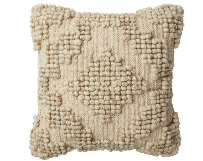 "17"" L x 17"" W. Made of wool and cotton.Promising review: ""I love the texture this pillow offers, plus its neutral color will pair nicely with whatever other decor you have. It is very reasonable as you'd expect to pay three times this price elsewhere."" —JennyatBearLakePrice: $16.87"