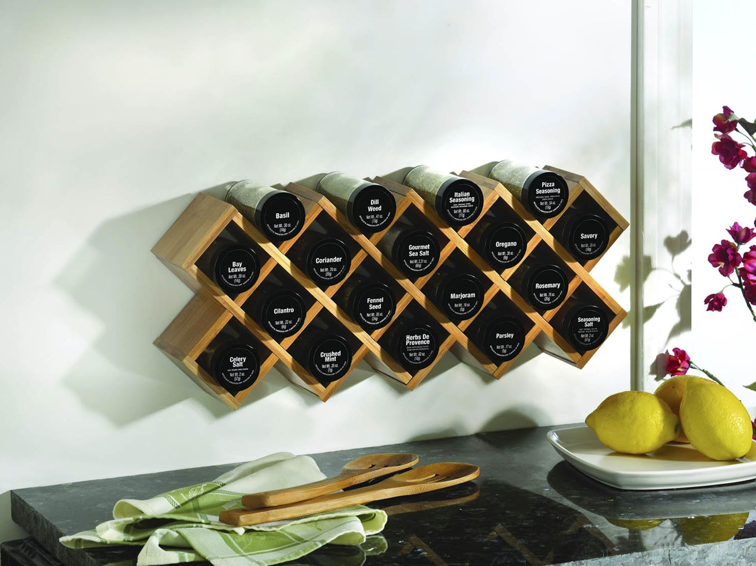 spice rack installed on wall with matching jars filled in each slot