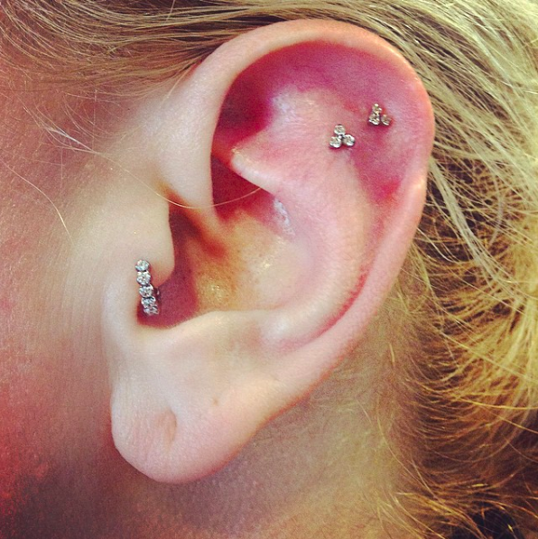 The tragus is that little inner ear flap. Tragus piercings take about 3-9 months to heal and rate pretty average on the pain tolerance scale.