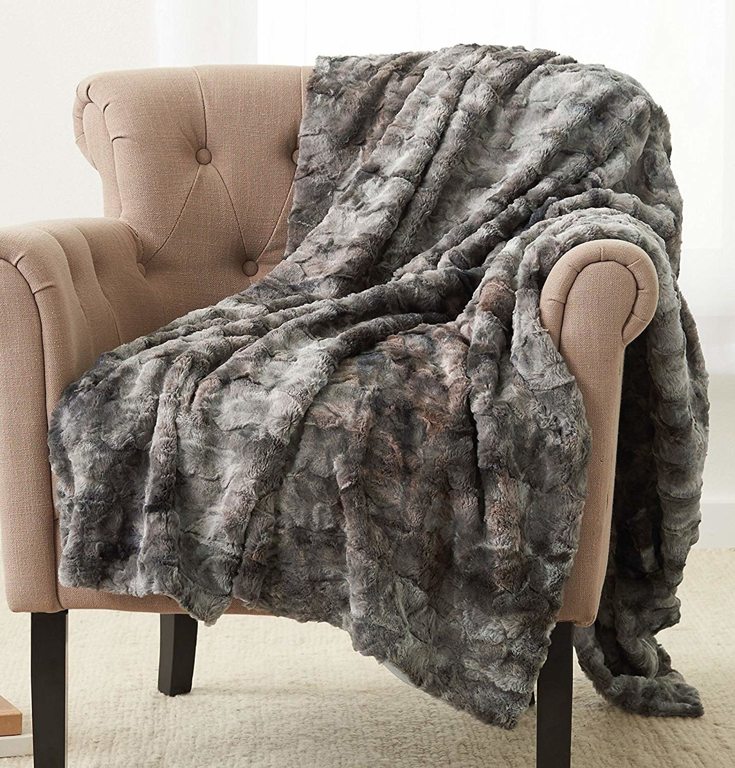 arm chair with light gray faux fur throw