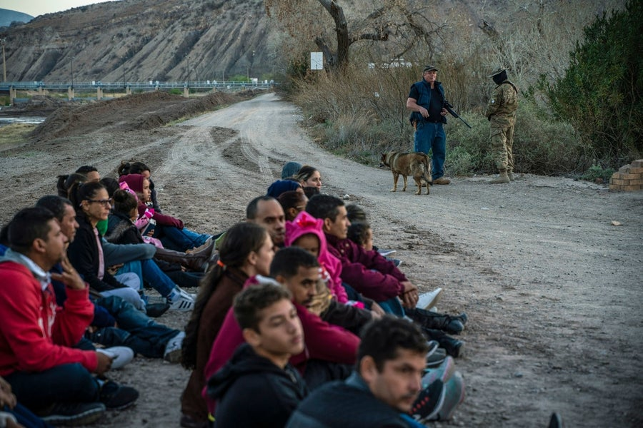 Dozens of people who had just crossed the US-Mexico border are detained in Sunland Park, New Mexico, by the United Constitutional Patriots.