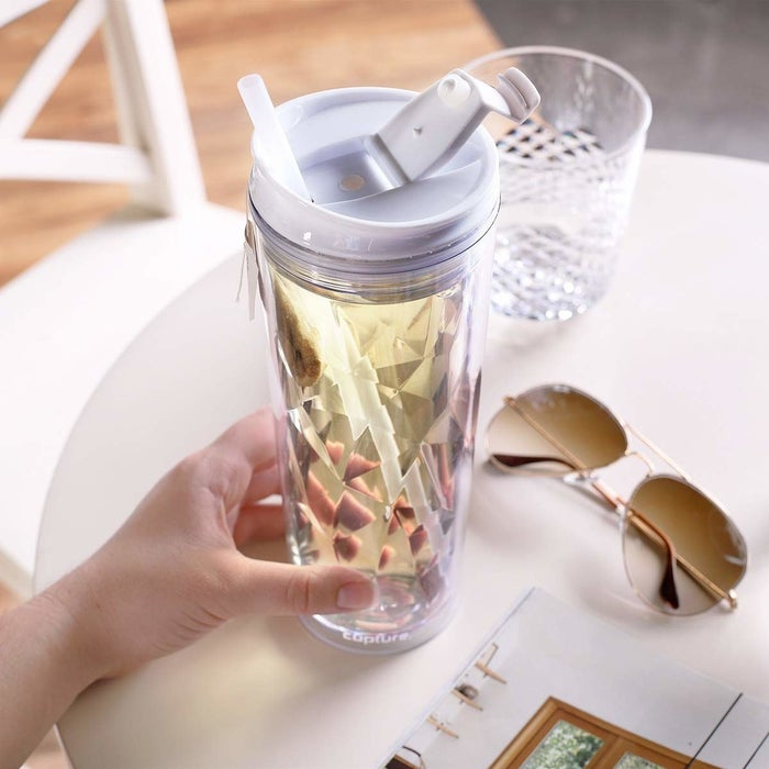 """It comes with a reusable straw, but can also be used without it!Promising review: """"This pretty cup makes it MUCH easier for me to drink five of these a day than any other bottle or glass I've had before. Maybe it's that it's see-through and easy to drink out of with a straw, like some type of psychological trick, but it works! I usually have water with fresh lemon in it and carry it around with me. Highly recommend."""" —Jana SchuberthGet it on Amazon for $11.99+ (five colors)."""