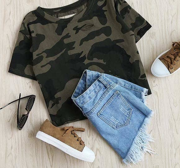 0e1cd7ca2076e A distressed crop tee in a camo print that'll make a ~sneaky~ transition  from your gym bag to your casual wardrobe. Amazon