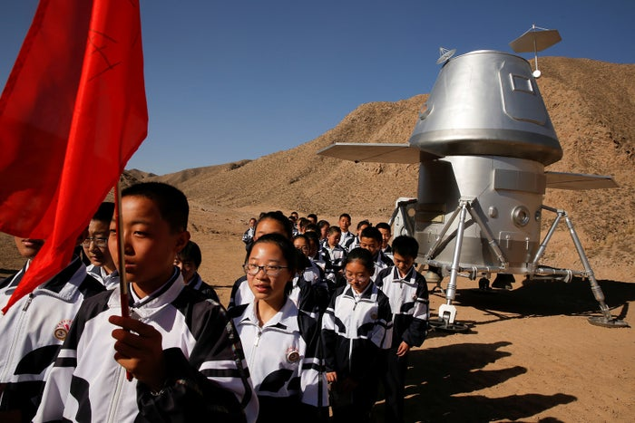 Students leave a mock space capsule after a lesson at the C-Space Project Mars simulation base, April 17.