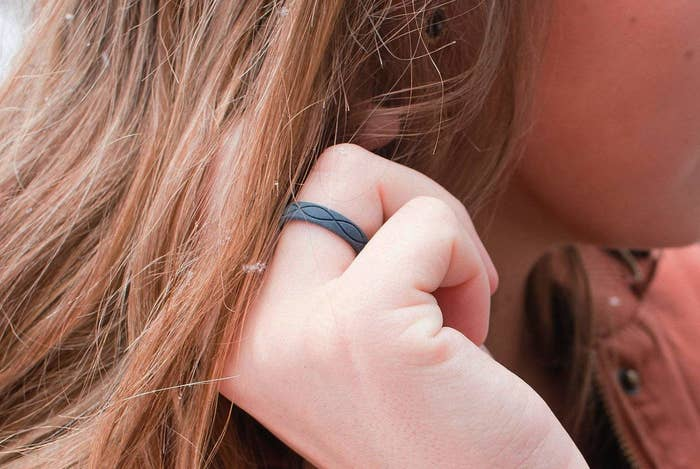 person wearing the ring