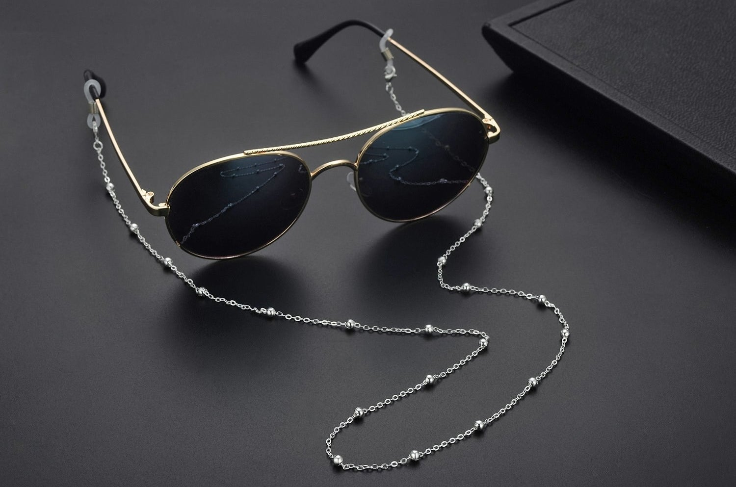 Sunglasses with the chain attached to the arms