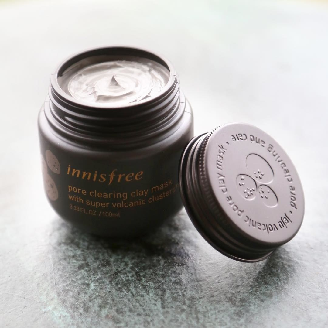Open jar of mask to show creamy texture