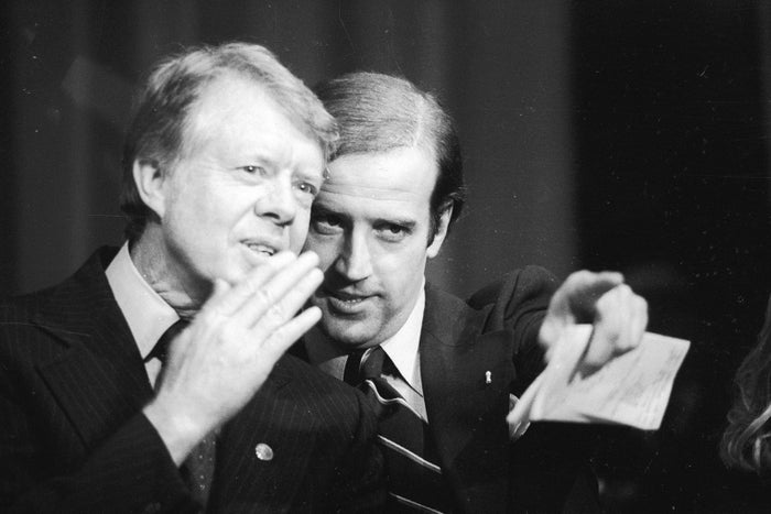 Biden points out a friend in the crowd at the Padua Academy to then-president Jimmy Carter during a fundraiser, Feb. 20, 1978.