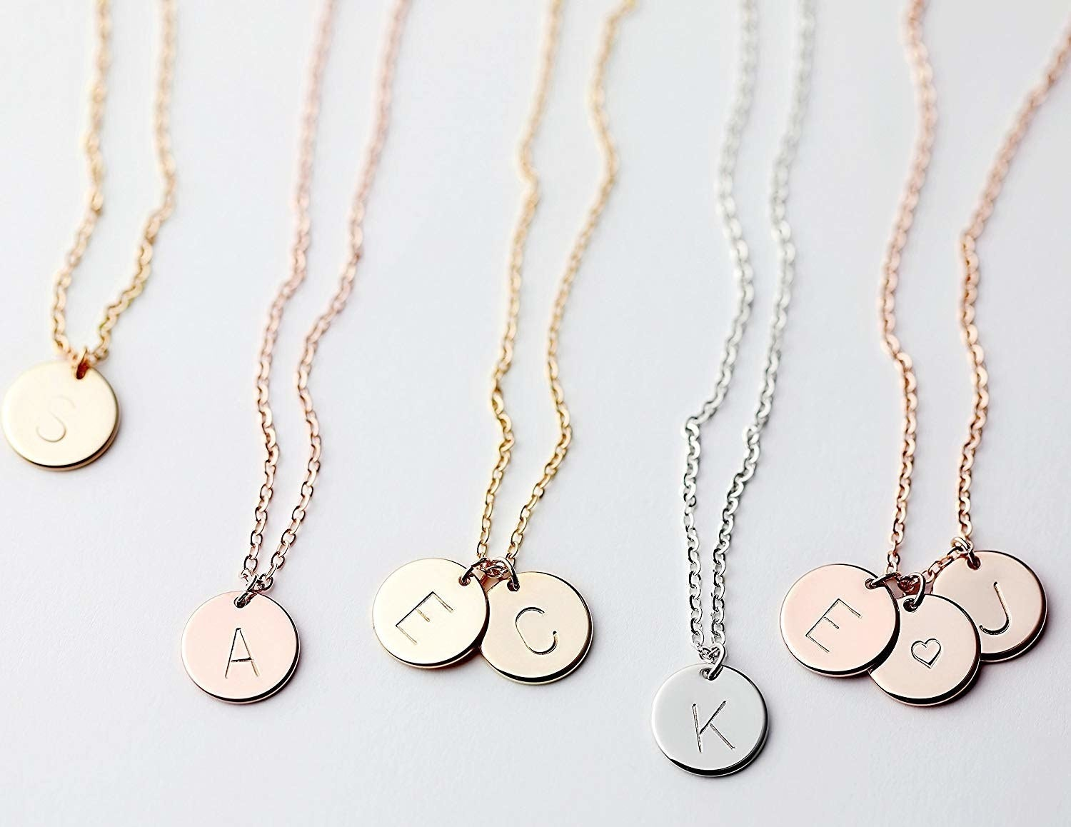 "Promising review: ""Bought this as a gift for my best friend's birthday. I ordered the silver necklace with three silver discs. Very pretty and shiny. I know she will love it. If it didn't have her initials on there I would be tempted to keep it for myself! I am considering going back for the rose gold for me! Great gift that arrived quickly."" —LauraATXGet it from Amazon for $17.99 (available in three styles and 10 lengths)."