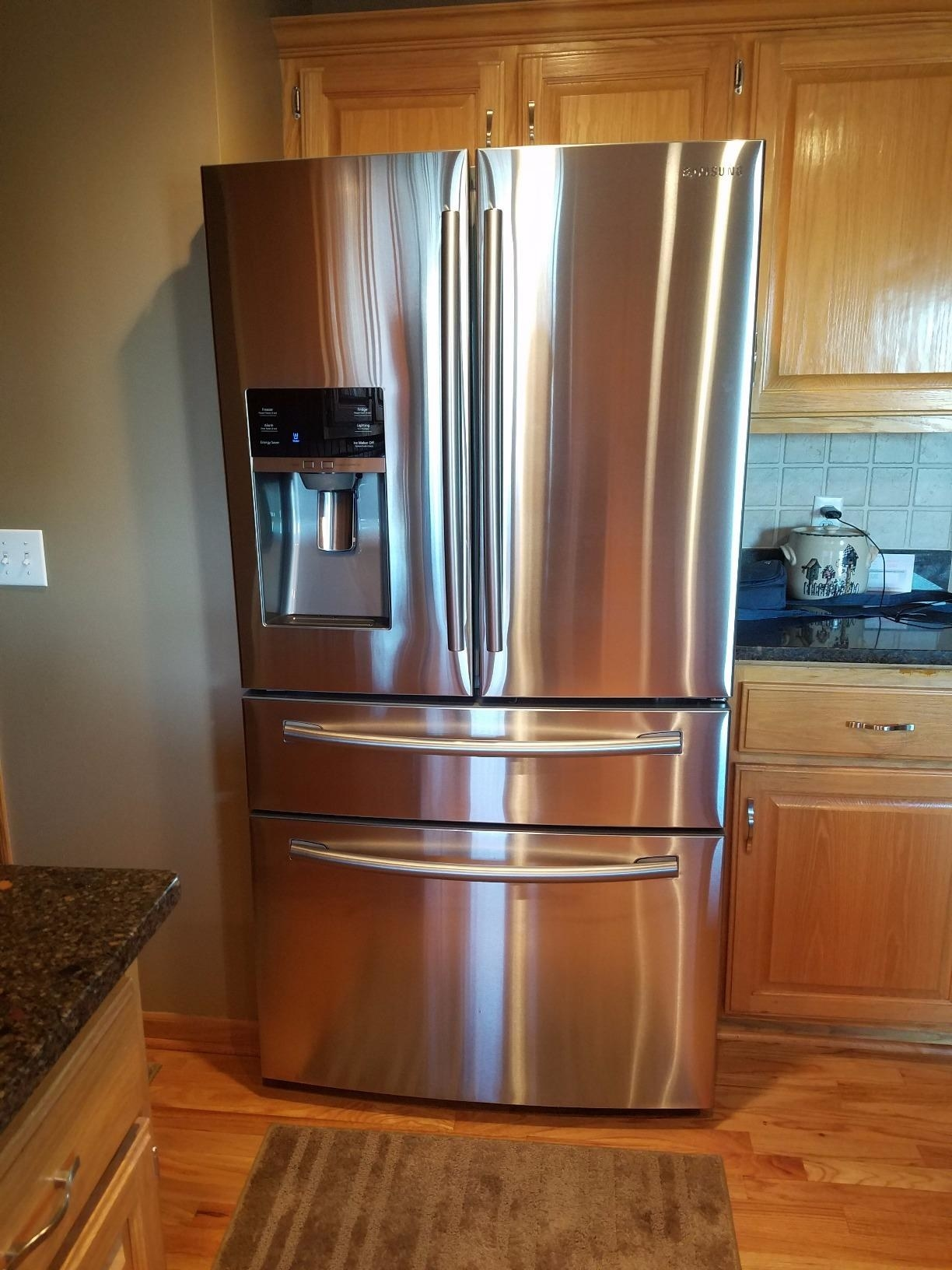 A review image of a super shiny stainless steel fridge