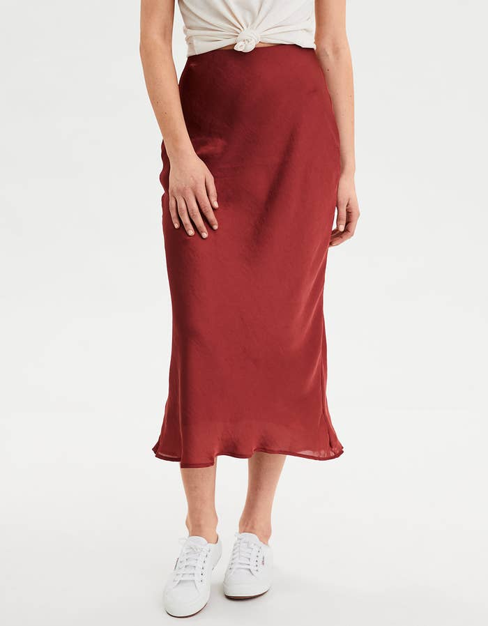 38f3609791 A sultry, silky midi skirt you can ~slip~ into whenever you want to feel  effortlessly chic, no matter where you're going.