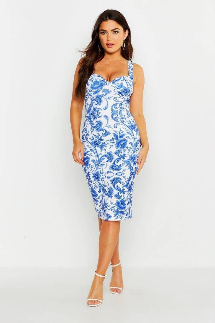 1f8f995cdc4 A porcelain print midi dress perfect for any fancy occasion. From champagne  toast birthday parties to black tie galas that serve caviar
