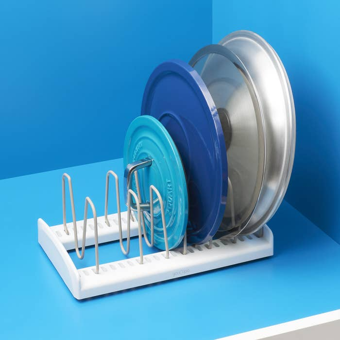 """Promising review:""""This is exactly what I need for my pot lids. They always seem too big for any other type of organizer. But being that this is adjustable, they fit perfectly. This organizer is also non-slip, so you don't have to chase it all over the cabinet to retrieve your lid."""" —DeppLoverGet it from Walmart for$15."""