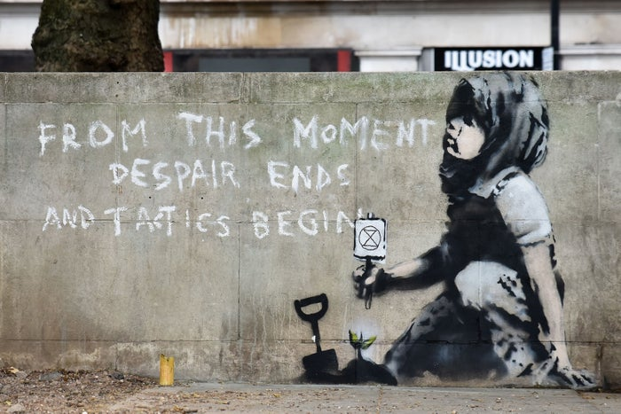A new graffiti work by Banksy is seen at Marble Arch in London, April 26, following a widespread Extinction Rebellion protest for the climate.