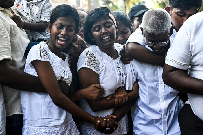 Relatives mourn during a burial ceremony of bomb blast victims in Colombo, Sri Lanka, April 24.
