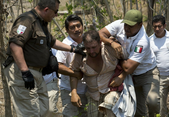 A Central American man is detained by Mexican immigration agents on the highway to Pijijiapan, Mexico.