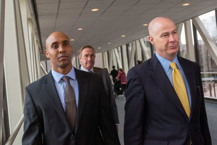 Mohamed Noor (left) with his attorneys.