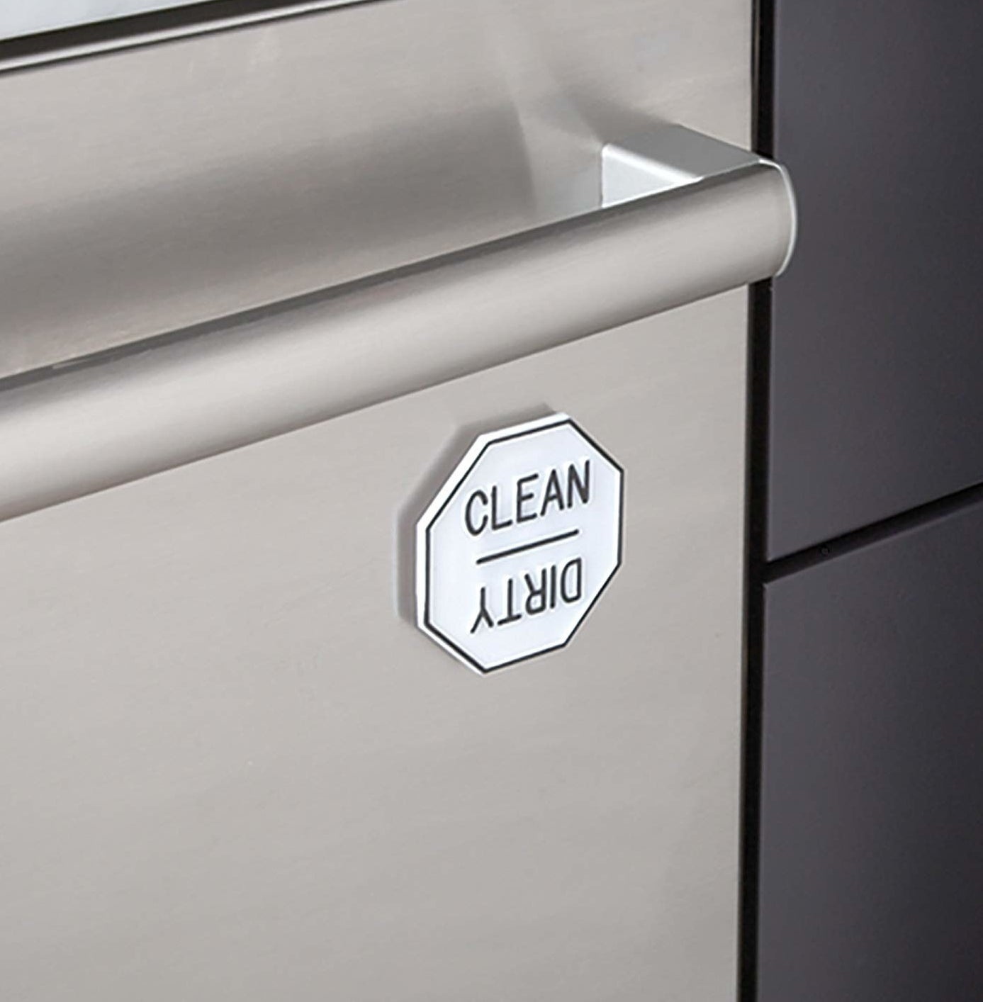 "white magnet on dishwasher that can be turned to read ""clean"" or ""dirty"""