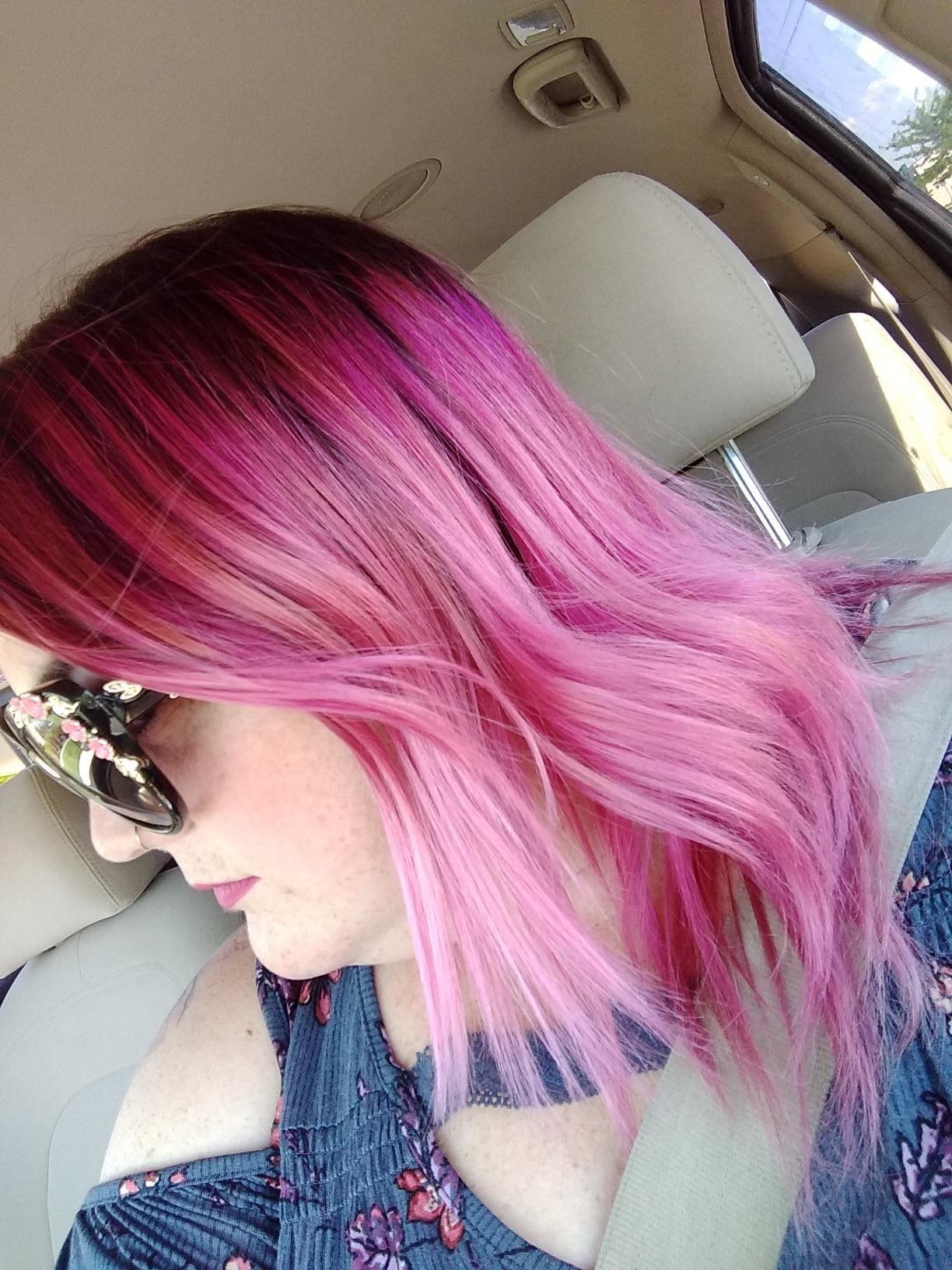 A reviewer's bleached and dyed pink hair looking shiny