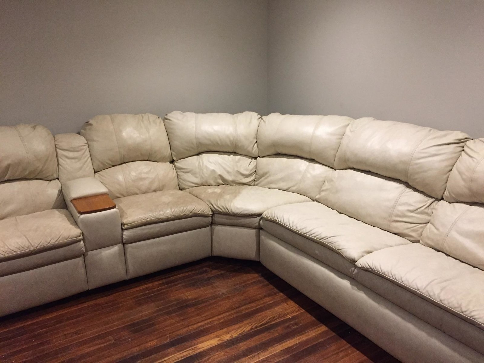 white couch half cleaned looking tan on one side and bright white on the other