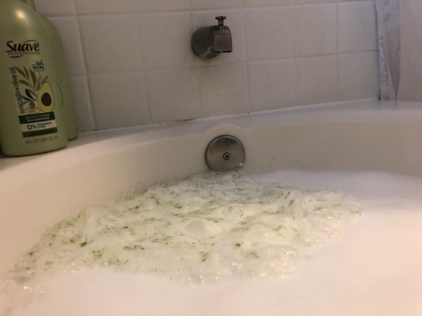 dirty green foam in tub